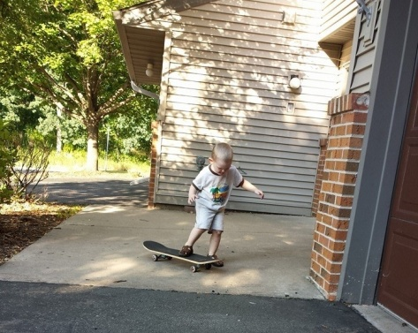 Isaac  trying Skateboard at 2